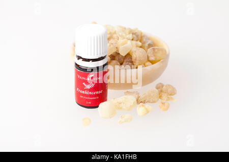 VILNIUS, LITHUANIA - 21 SEPTEMBER, 2017: Bottle of Young Living Frankincense100% Pure Essential Oil and Frankincense - Stock Photo