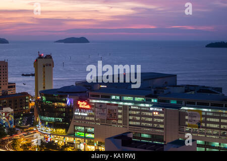 Kota Kinabalu at night with view featuring Suria Sabah and South China Sea - Stock Photo