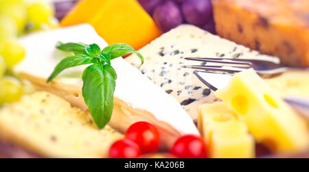 Closeup photo of a tasty cheese assorted, blue cheese, brie, camembert, cheddar, gouda, luxury French cheese, delicious - Stock Photo