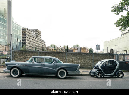 1960's Buick Saloon with 2013 Renault Twizy electric car in London. - Stock Photo