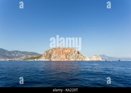 Seascape with Alanya's castle rock and mountains as backgroung shot on sunny day Alanya peninsula - Stock Photo