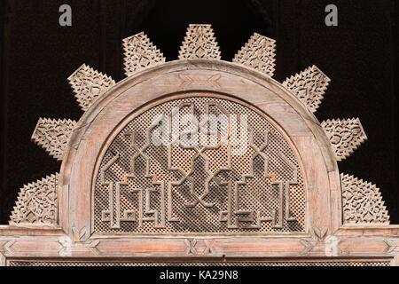 Wood carvings in the Al-Attarine Madrasa, in Fez, Morocco - Stock Photo