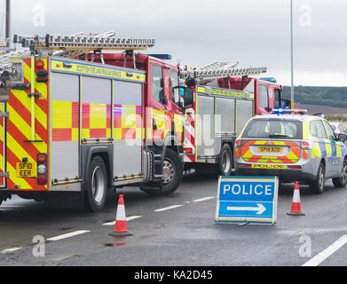 emergency services vehicles at a road traffic accident, Scotland, UK - Stock Photo