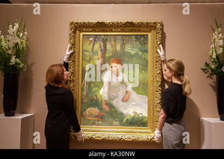 London,UK,25th August 2017,Noon in the Hayfield, by George Clausen, leads the photo call for Bonhams 19th Century - Stock Photo