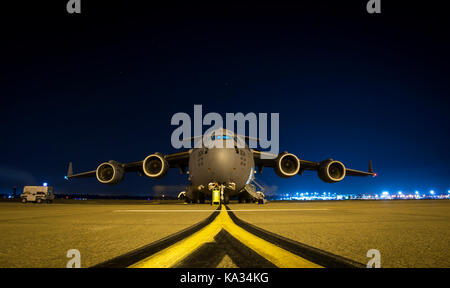 A U.S. Air Force C-17 Globemaster III sits on the flightline Sept. 23, 2017, at Joint Base Charleston, S.C. Airmen - Stock Photo