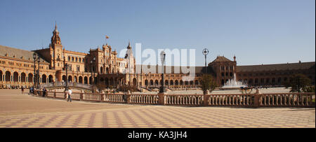 Plaza de Espana in Seville (Spain), Spain with bridges over the canal, towers and main entrance to the building. - Stock Photo
