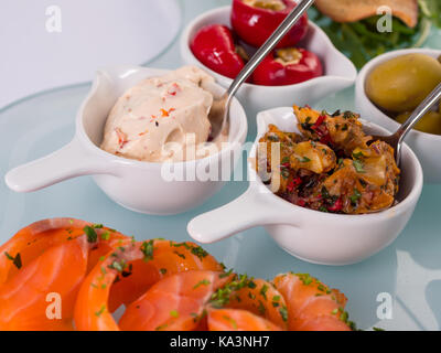 Snack set. Oktoberfest food frame concept. Variety of humus, olives, vegetables, cheese and sauces on white background. - Stock Photo