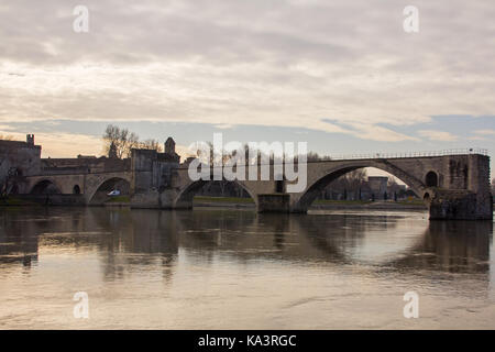 Historic Pont d'Avignon Bridge with reflection in the Rhone River. Avignon, France. Winter evening light. - Stock Photo