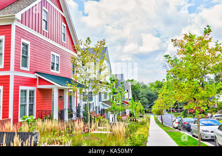 Silver Spring, USA - September 16, 2017: Colorful multicolored red, blue painted residential new townhouses, homes, - Stock Photo