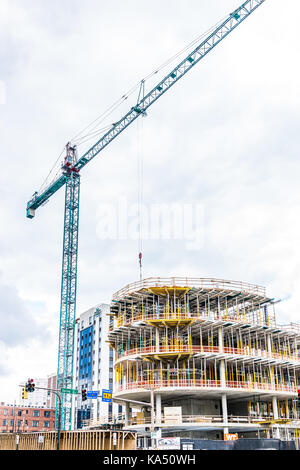 Silver Spring, USA - September 16, 2017: New construction in downtown area of city in Maryland with cars on street, - Stock Photo