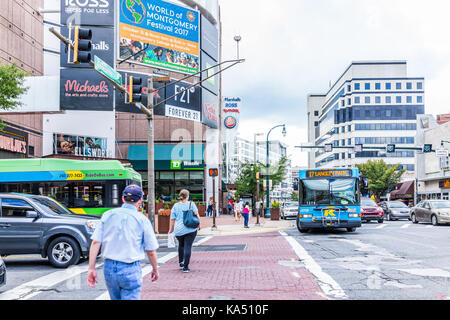 Silver Spring, USA - September 16, 2017: Downtown area of city in Maryland with cars on street, bus, and shopping - Stock Photo