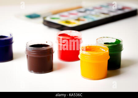 Painting, drawing, art background. Colorful gouache and paints on white table - Stock Photo