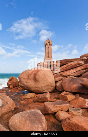Famous lighthouse of Ploumanac'h in Brittany between large granite boulders - Stock Photo
