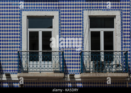 Building facade with ceramic tiles typical of lisbon for Closed balcony