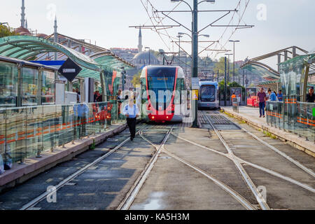 Istanbul, Turkey- September 21, 2017: View of a metro stop in Istanbul, Turkey, with mosque in the background, and - Stock Photo