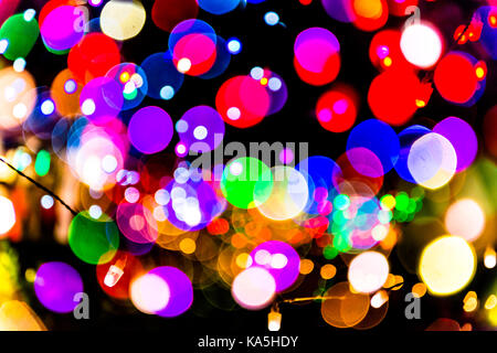 Abstract dot patterns double exposures of out of focus fairy lights on a beach in Kerala. - Stock Photo