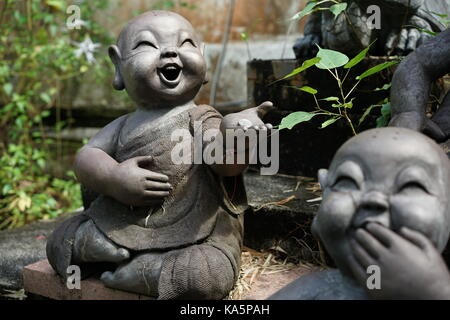 little Buddhist monk statue at Singapore Chinese garden - Stock Photo