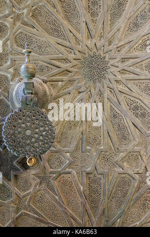 Elaborate metal door of Bou Inania Madrasa with star pattern and beautiful door handle, Fes, Morocco, North Africa. - Stock Photo