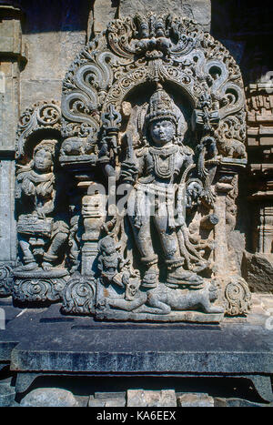 Shiva dancing on demon sculpture, Chennakesava temple, belur, karnataka, India, Asia - Stock Photo