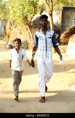 Portrait of unidentified Indian boys walking on the street - Stock Photo