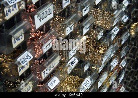 Small jewellery components in factory sampling store. - Stock Photo