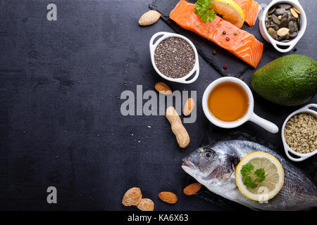 Black table with ingredients of food rich in vitamin D and omega 3, with copy space. - Stock Photo