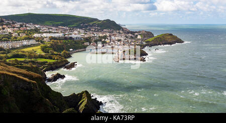 Seaside town of Ilfracombe in North Devon, England. Panoramic view from high cliffs on the South West coast path. - Stock Photo