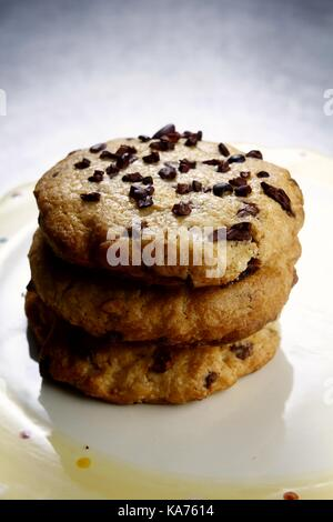 Photo of a stack of chocolate chip cookies - Stock Photo