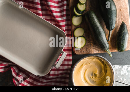 Form for roasting, zucchini, cheese sauce mornay diagonal horizontal - Stock Photo