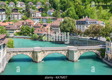 Bern, Switzerland - May 26, 2016: Architecture of the old European town, coastal cityscape with river and bridge - Stock Photo