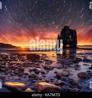 starry sky in a spectacular rock in the sea on the Northern coast of Iceland. Legends say it is a petrified troll - Stock Photo
