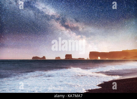 The Rock Troll Toes. Reynisdrangar cliffs. Black sand beach. Iceland - Stock Photo