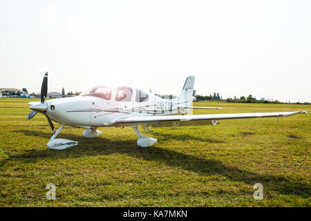 PRAGUE, CZECH REPUBLIC - 9.09.2017: White Propeller plane parking at the airport in Sunny day, Prague - Stock Photo