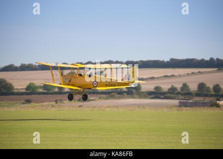 Duxford, UK. 24th Sep, 2017. DeHavilland Tiger Moth at the Duxford Battle of Britain Air Show in Duxford, UK. Credit: - Stock Photo