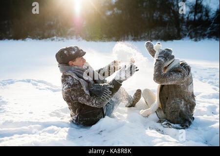 Beautiful senior couple in sunny winter nature. - Stock Photo