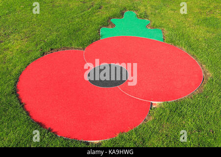 Remembrance Poppy, red poppies, logo, symbol, set in lawn, grass, Hunstanton, Norfolk, England, UK, emblem - Stock Photo