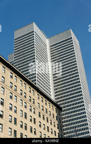 Confederation Building and Place Ville Marie office tower from McGill College Avenue in downtown Montreal, Quebec, - Stock Photo