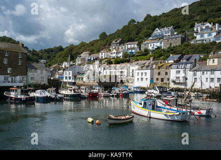 boats moored in Polperro harbour south coast of Cornwall UK - Stock Photo