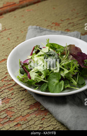 Fresh green vegetables in bowl, food closeup - Stock Photo