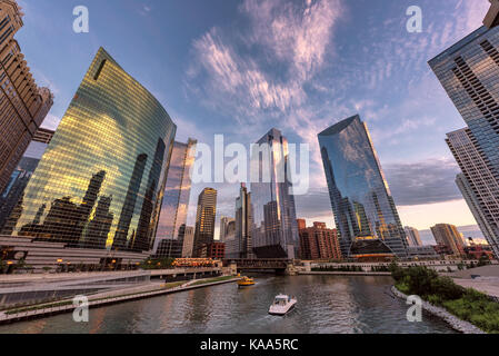 Chicago downtown and Chicago River with bridges during sunset. - Stock Photo