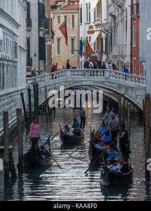 A ridiculously crowded Rialto Bridge in Venice with tourists packed, looking over the Grand Canal - huge pressure - Stock Photo