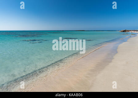 Unspoiled beauty of crystal clear water of Elafonissi beach Crete - Stock Photo