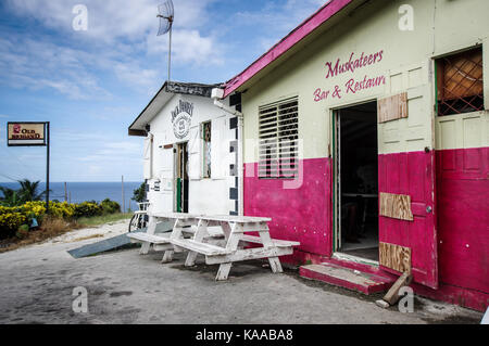 Colourful local pub and rum shop near Martin's Bay on the east coast of Barbados - Stock Photo
