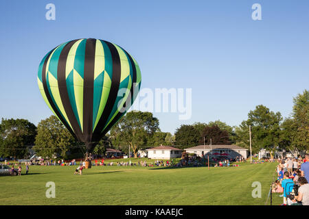 Seymour, WI - August 12, 2017:  Hot air balloon being sent aloft during Hamburger Fest in Seymour, WI.  Hot air balloons are an integral part of the a
