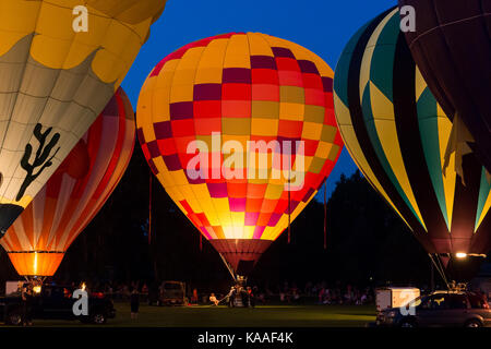 Seymour, WI - August 12, 2017:  Hot air balloon glow during Hamburger Fest in Seymour, WI.  Hot air balloons are an integral part of the annual festiv