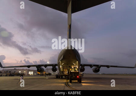 Members from 502nd Logistics Readiness Squadron load supplies onto a  C-17 Globemaster III at Joint Base San Antonio - Stock Photo