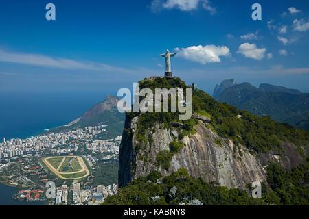 Christ the Redeemer atop Corcovado, and Jockey Club Brasileiro, Rio de Janeiro, Brazil, South America - aerial - Stock Photo