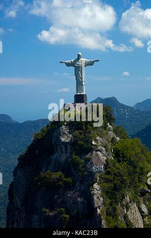 Christ the Redeemer statue atop Corcovado, Rio de Janeiro, Brazil, South America - aerial - Stock Photo