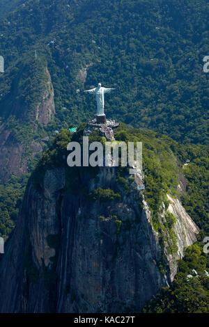 Giant statue of Christ the Redeemer atop Corcovado, Rio de Janeiro, Brazil, South America - aerial - Stock Photo