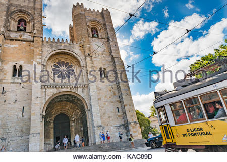 Historical tram of Lisbon in front of Patriarchal Cathedral of St. Mary Major - Stock Photo